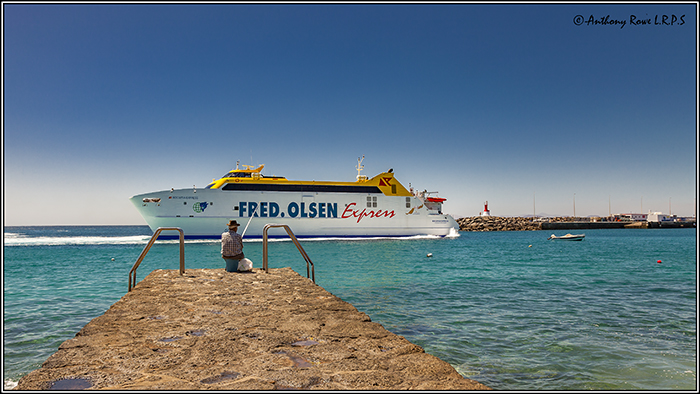 FERRY AND FISHERMAN