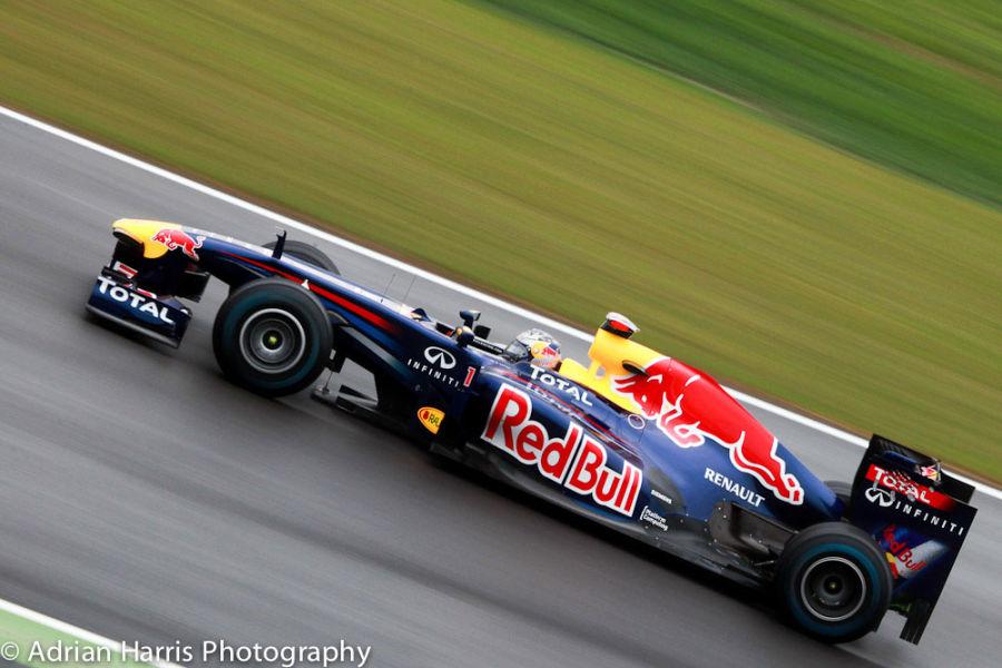 Vettel speeds in the wet