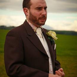 Groom Checks The Wedding Ring