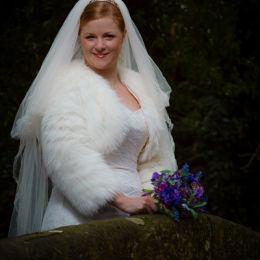 Bride Smiling on Bridge