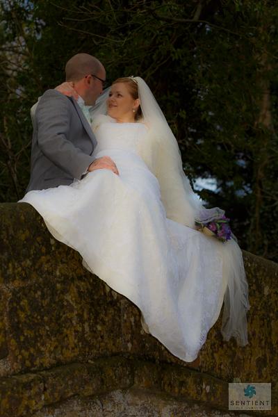 Groom & Bride Reclining on Bridge