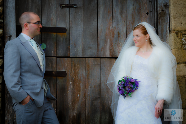 Groom & Bride Across The Barn Door