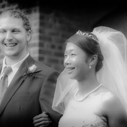 Bride & Groom Smile Outside Church