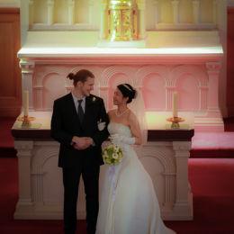 Groom & Bride In Front of Altar