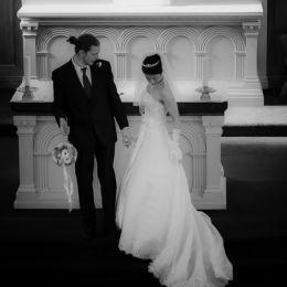 Groom With Bouquet - Bride Checks Dress
