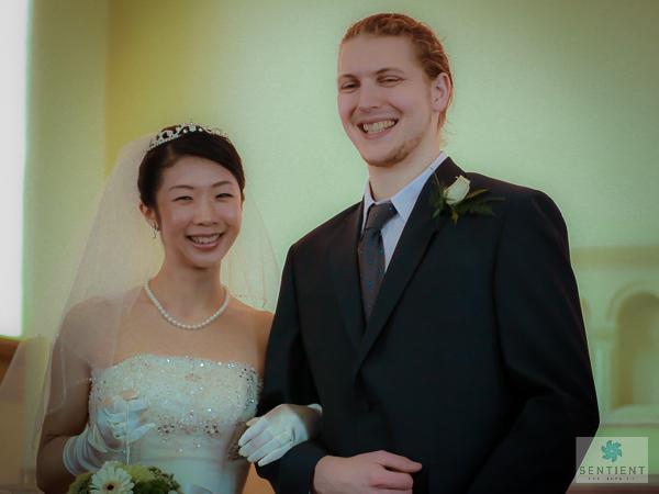 Bride & Groom Smile In Church