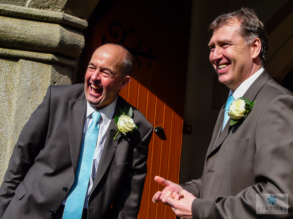 Groom & Best Man Have a Laugh