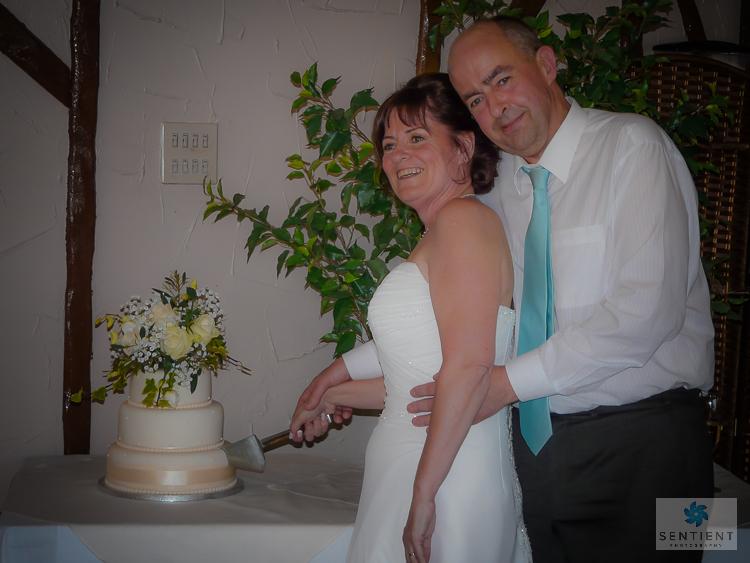 Bride & Groom Cut Wedding Cake