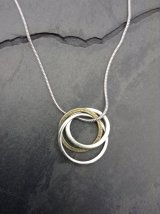 Silver and brass rings pendant £40