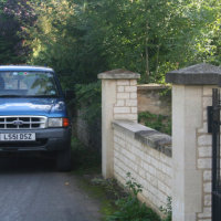 Mortared wall with Ashlar gate pillars and Capping
