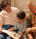 Henry reading with Grandma and Grandfather