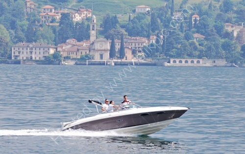 Speed boat passing Bellagio