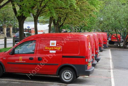 Red vans in a row
