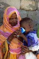 Eritrean Woman Feeding Children