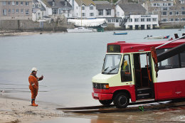"A New Bus Arrives on the Scilly Isles, This Image was used on ""Have I got News for you"" by the BBC."