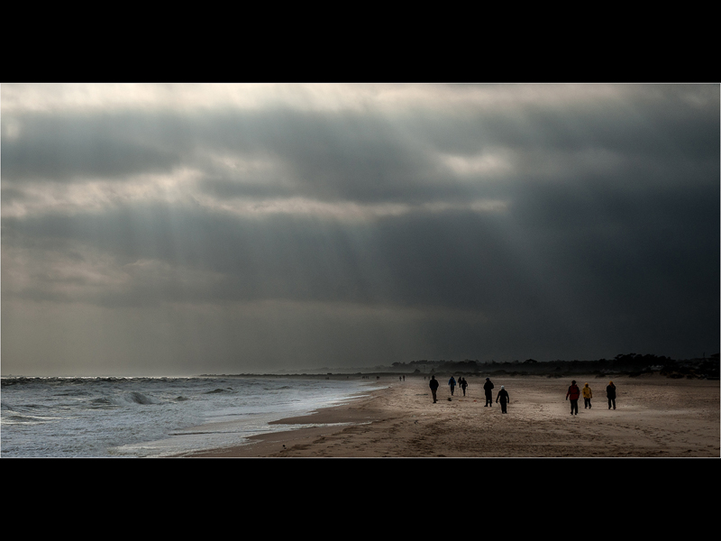 Com Stormy beach by Michael Poole