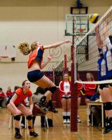 Volleyball star Olivia Bowman issues crushing smash.
