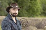 Country music star Tyler Cochrane, down on the farm.