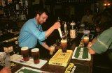 Barman serving Pints of real ale.