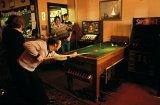 Bar billiards game in a pub,