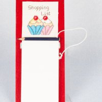 Cross stitch shopping list board.