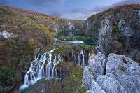 Autumn sunset above waterfall Sastavci, National Park Plitvice Lakes, Croatia