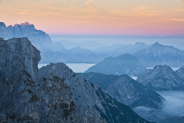Alpenglow, italian section of Julian Alps seen from Mangart pass, Slovenia