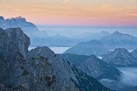 Alpenglow, italian section of Julian Alps seen from Mangart pass, Slovenia