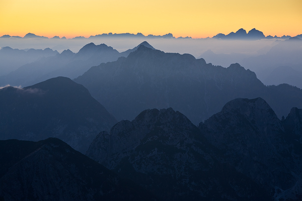 Peaks of eastern Tyrol, Slovenia/Austria border in Alps seen from Mangart Pass, Slovenia