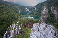 Sun sets above Sastavci waterfall, National Park Plitvice Lakes, Croatia
