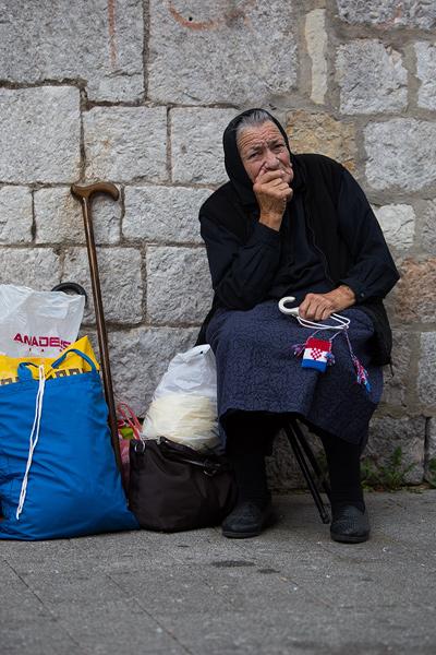 Old lady in town Sinj, Dalmatia, Croatia