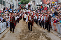 Alkar's squire marchin to the beat of drum during Alka tournament in town Sinj, Croatia