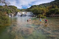 Coolin off under Skradinski Buk waterfall, National Park Krka river, Dalmatia, Croatia