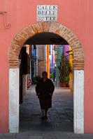 Old passage on the island Burano near Venice, Italy