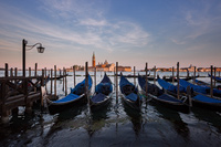 Gondolas at sunset, Venice, Italy
