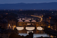 Night falling on Ponte Vecchio famous bridge on river Arno in Florence, Tuscany, Italy