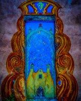 Colourful doorway art, adobe house