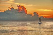Sailling in setting Sun.