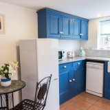 Enjoy a coffee at the table in Wills Cottage Kitchen