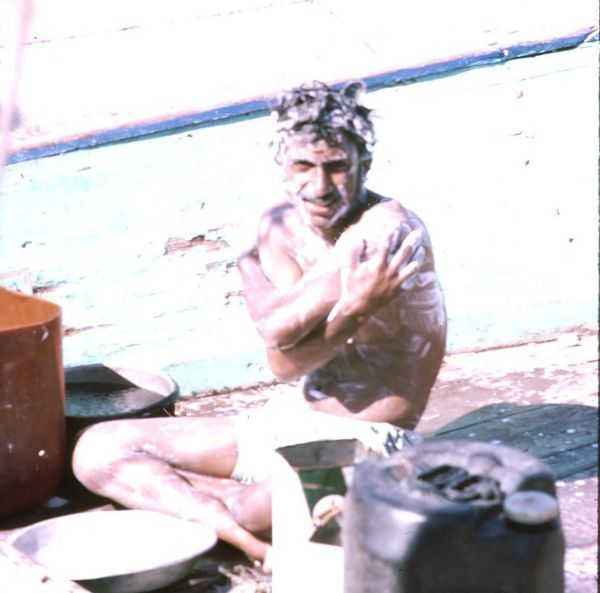 Sailor bathing on Dhow, Dubai Creek
