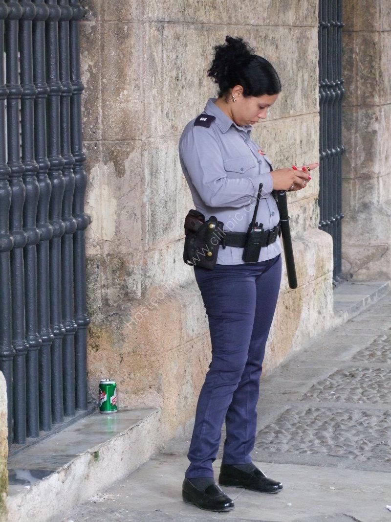 Cuban Police Woman with Gun & Painted Nails!, Plaza Armas, Havana