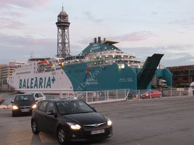 Ferry Balearia offloading vehicles at sunset