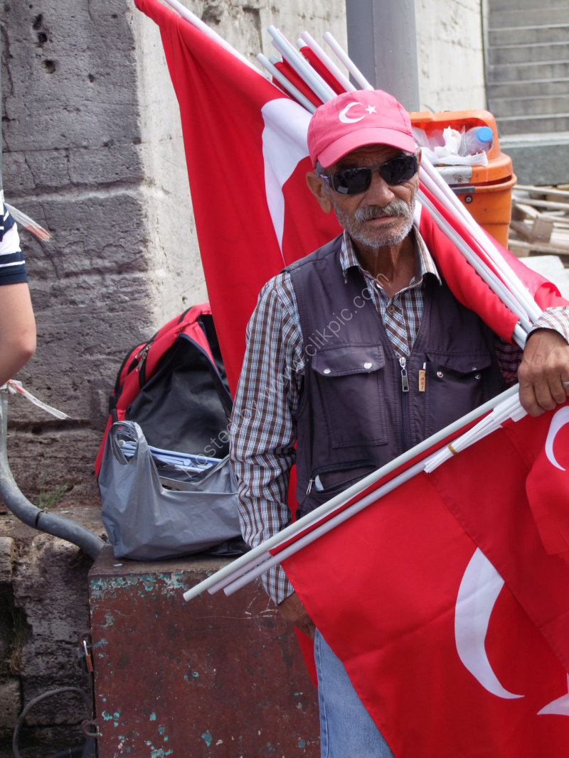 Turkish Man selling Turkish Flags in front of New Mosque, Istanbul
