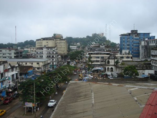 Abandoned Ducor Intercontinental Hotel on hill in background, Monrovia, Liberia