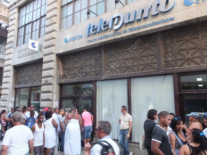 Cubans queuing to telephone at telephone exchange, Obispo Street, Havana