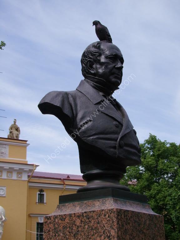 Bird perched on Bronze Bust, Admiralty Park, St Petersburg