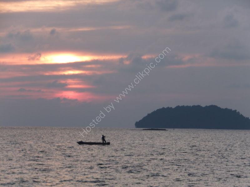 Sunset & Fisherman