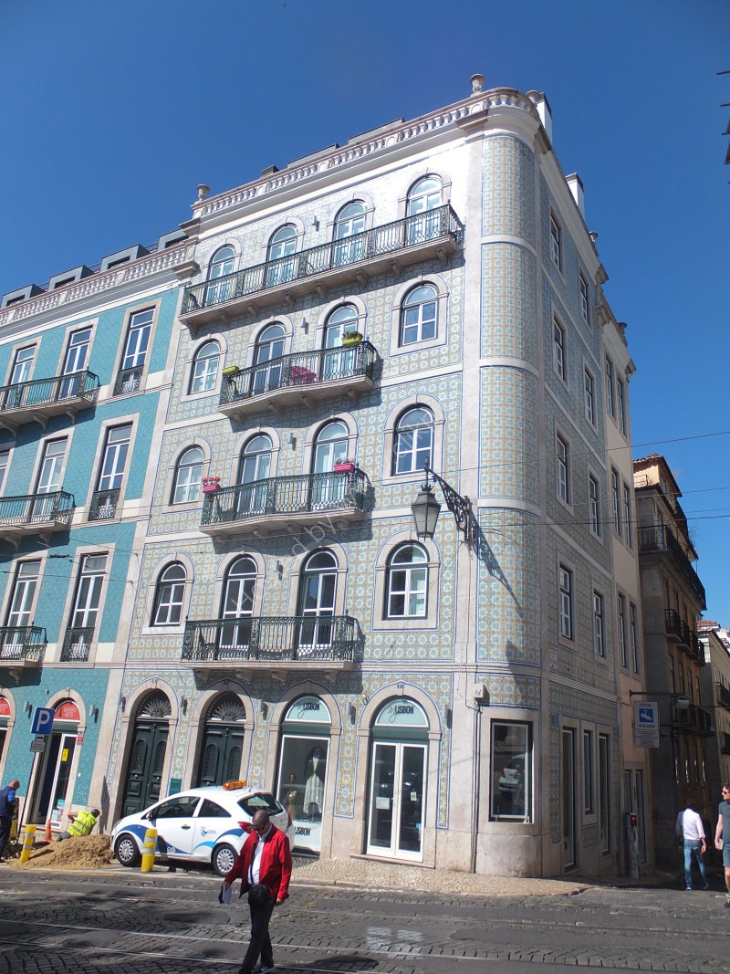 Traditional Portuguese Tiled Building with Balconies
