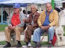 Cubans watching Passersby in Park, Havana