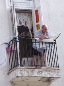 Cuban overlooking passersby, Leonor Perez Street (Paula), Havana